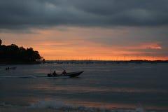 Fishing boat. Singapore Changi beach fishing and nightsky aircraft Royalty Free Stock Photo