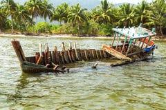 Fishing boat sinking Stock Photography