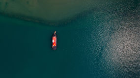 Fishing boat. Small empty fishing boat near beach village from top view stock image