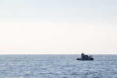 Fishing Boat. Small fishing out on the Pacific ocean water Stock Images