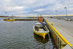 Fishing boat in the small port Royalty Free Stock Image