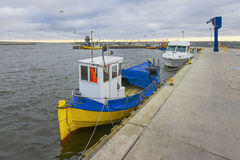 Fishing boat in the small port Royalty Free Stock Photos