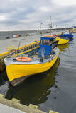 Fishing boat in the small port Royalty Free Stock Images