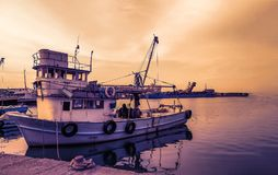 Fishing boat standing on the shore at sunset. Fishing boat on the Black Sea coast of Turkey Royalty Free Stock Photos
