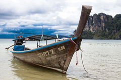 Fishing boat stands at the beach, after a night of tuna fishing. Thai national boat. Thailand Royalty Free Stock Photo