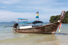 Fishing boat stands at the beach, after a night of tuna fishing. Thai national boat. Thailand Stock Image