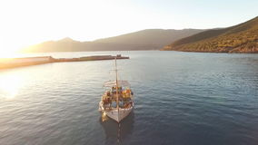 A fishing boat stands on the water in the harbor. stock footage
