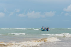 Fishing boat in a storm approaching Royalty Free Stock Photos