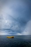 Fishing boat in stormy sea Stock Image
