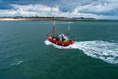 Fishing boat on stormy weather Stock Photos