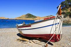 Fishing boat stranded on the beach in the Costa Brava, Spain Royalty Free Stock Image