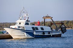 Fishing boat in summer outside in sea at harbour Royalty Free Stock Image