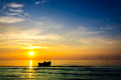Fishing boat sun rise Stock Photo