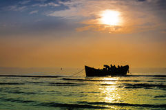 Fishing boat sun rise Stock Image
