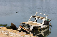 Fishing boat almost sunk Stock Image