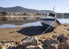 Fishing boat on a sunny afternoon on the calm Aegean Sea on the island of Evia, Greece. Fishing boat on a sunny afternoon on the calm Aegean Sea on the island of royalty free stock image