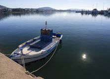 Fishing boat on a sunny afternoon on the calm Aegean Sea on the island of Evia, Greece. Fishing boat on a sunny afternoon on the calm Aegean Sea on the island of royalty free stock photos