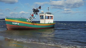 Fishing boat in sunny scenery at the Baltic Sea in Sopot, Poland. stock video
