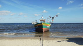 Fishing boat in sunny scenery at the Baltic Sea in Sopot, Poland. stock video footage