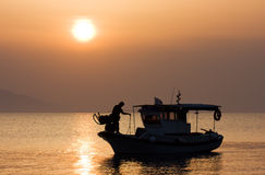 Fishing boat at sunrise Stock Images