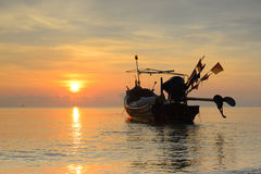 Fishing boat with sunrise backdrop. Royalty Free Stock Photo