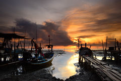 Fishing boat with sunrise background Royalty Free Stock Image