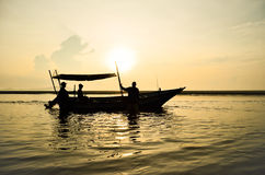 Fishing Boat at Sunrise Royalty Free Stock Photos