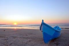 Fishing boat and sunrise Stock Photos