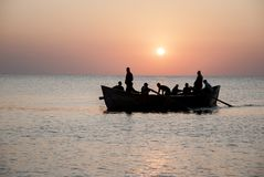 Fishing boat at sunrise at the Black Sea. With fisherman getting ready for a new day Royalty Free Stock Image