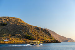 Fishing Boat By Sunrise. Fishing boat heading out to the mediterranean sea in the early morning Stock Images