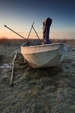 Fishing boat at sunrise on land Stock Images