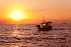 Fishing boat in sunrise at Mediterranean sea. Traditional fishery Stock Photo