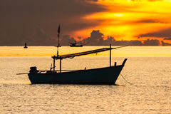 Fishing boat in sunrise mood Stock Image