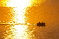 Fishing boat at sunrise. Stock Photos