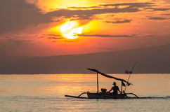 Fishing boat at sunrise. By the sea Royalty Free Stock Photography