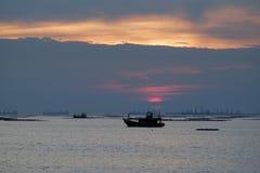 Fishing boat. Sunrise sea silhouette Royalty Free Stock Photos