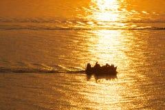 Fishing boat at sunrise. Stock Images