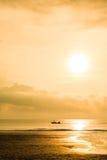Fishing boat sunrise stock image