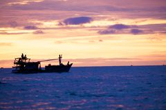 Fishing boat at sunset Stock Photography
