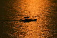 Fishing boat in Sunset Royalty Free Stock Photos