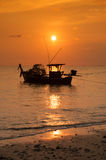 Fishing boat and sunset Stock Photography