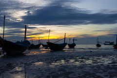 Fishing boat at sunset. Back lit traler on the ocean at sunset Stock Images