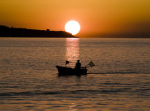 Fishing boat at sunset Royalty Free Stock Photos
