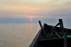 Fishing boat in sunset Stock Image