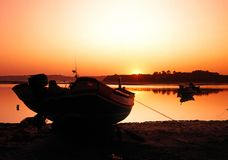 Fishing boat at sunset, Alvor, Portugal. Royalty Free Stock Image