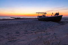 Fishing boat at sunset Stock Images