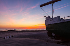 Fishing boat at sunset Royalty Free Stock Images