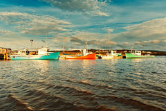Fishing boat during sunset in the harbour Royalty Free Stock Images