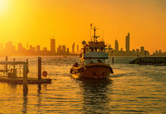 Fishing boat during sunset in kuwait royalty free stock photography