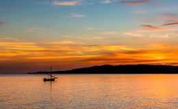 Fishing boat at sunset. Landscape with a fisching boat at sunset in sardinia Stock Images
